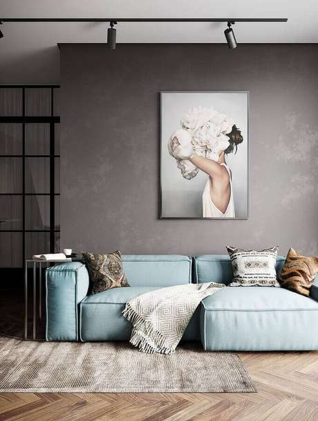 46. Sofá modernos para sala com estilo contemporânea decorada com parede de cimento queimado e spots de luz – Foto: Behance