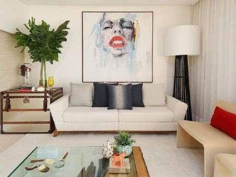 62. Sofás modernos para sala pequena decorada com quadro grande e luminária de chão – Foto: San Lombardi