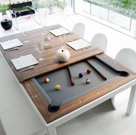 9. Aproveite a mesa retangular de jantar e transforme seu interior em uma mesa de sinuca. Fonte: Pinterest