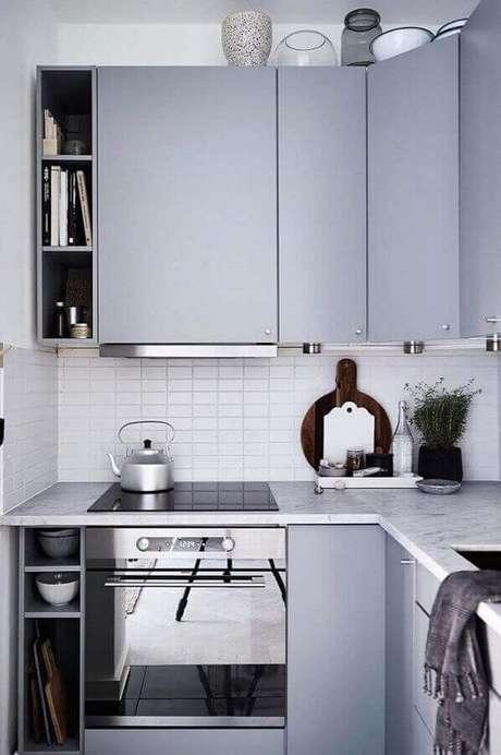 10. Em uma cozinha compacta o mais interessante é investir em um forno elétrico de embutir pequeno – Foto: Pinterest