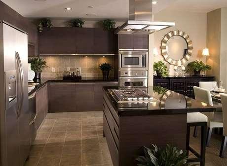 1. Moderna e sofisticada cozinha com granito preto