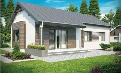 27. Para ter uma casa com cinza e branco, invista no telhado cinza e capriche no jardim!