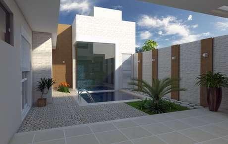 1. Neste projeto, o arquiteto Caio Pelisson usou várias arandelas externas na área da piscina