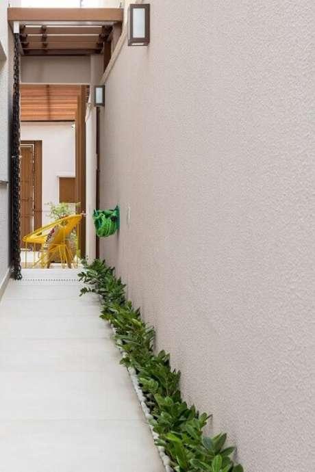 27. Arandelas externas no corredor. Projeto de Juliana Conforto