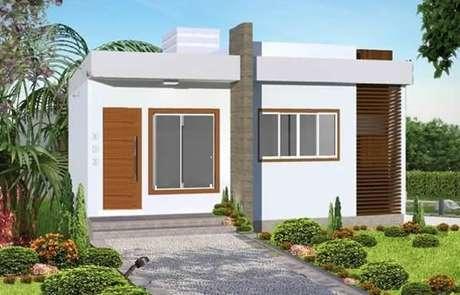 42 – Modelo de fachada para casas pequenas com garagem aberta.