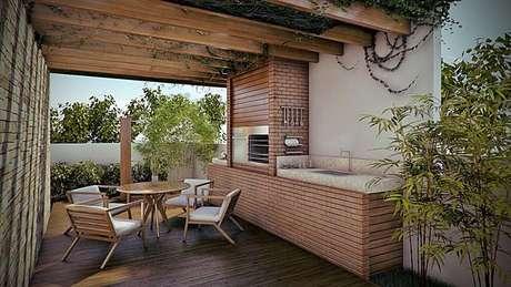48. A madeira é um elemento que pode ser utilizado no design da churrasqueira de tijolo. Projeto de Martins Lucean