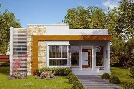 31. Usar materiais diferentes na fachada para casas pequenas pode trazer um toque de modernidade