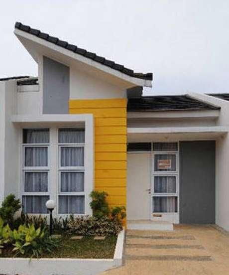 35. Usar cores fortes em alguns detalhes da fachada, podedeixar a casa simplesmais alegre