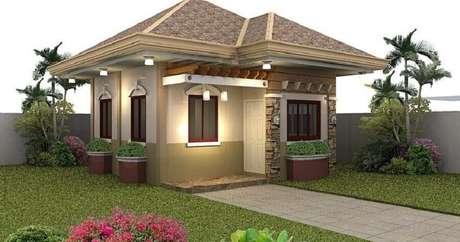 38. Invista na iluminação da fachada de sua casa simples para deixar mais aconchegante.