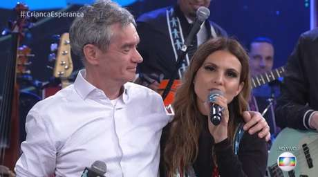 Serginho Groisman e a cantora Aline Barros
