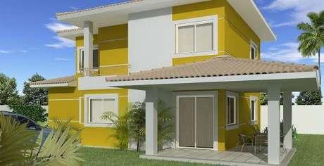 39. O amarelo é uma das cores para pinturas de casas mais chamativas e alegres – Por: Marcia Teixeira Arquitetura