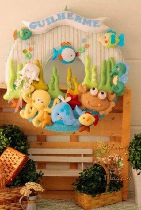 25. Use a guirlanda de feltro com temas divertidos para o quarto de bebê – Por: Pinterest