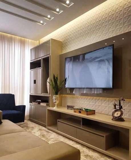 69. Esta sala de estar aposta na cor fendi para ganhar espaço. Foto: Instagram