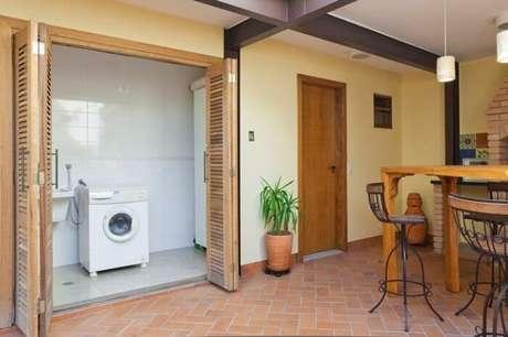68. Esconda a lavanderia com porta camarão. Fonte: Adell e Porto Arquitetura