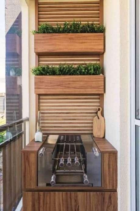 47. Horta vertical em cima da churrasqueira. Foto de Roofing Brooklyn
