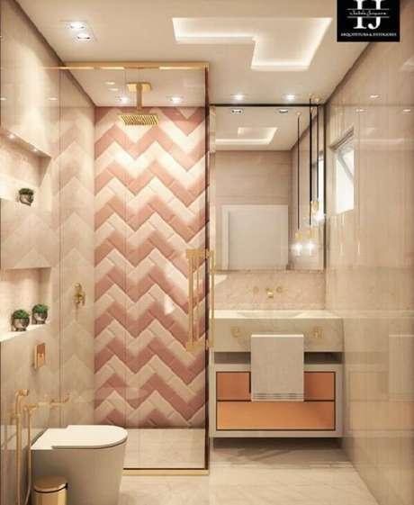 66. Azulejo para banheiro com estampa criativa em zigue-zague nos tons rosa e branco. Fonte: Pinterest