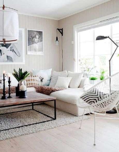 25. Sala de estar decorada com sofá de canto branco e luminária moderna – Foto: Futurist Architecture
