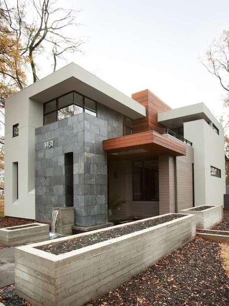 56. A fachada com revestimento de ardósia cinza é linda – Por: Pinterest