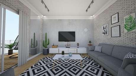 5. Projeto de sala de estar com tapete preto e branco geométrico. Fonte: Italo França
