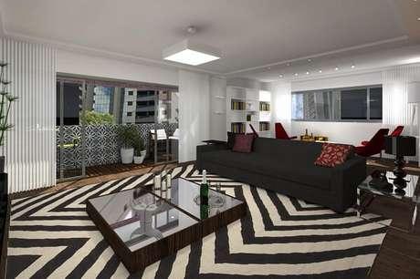 53. Sala de estar ampla com tapete preto e branco. Projeto por Juliana Lahoz