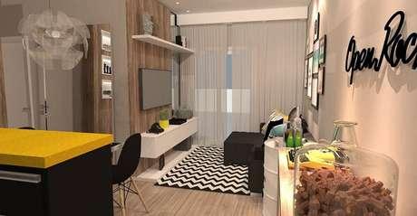 29. Sala de estar compacta com tapete preto e branco chevron. Projeto por Ana Paula Carvalho