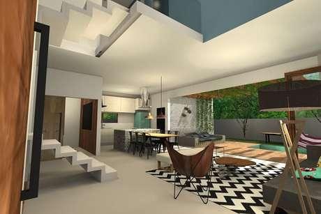 31. Sala de estar integrada com área externa conta com tapete chevron preto e branco. Projeto por Letícia Oliveira