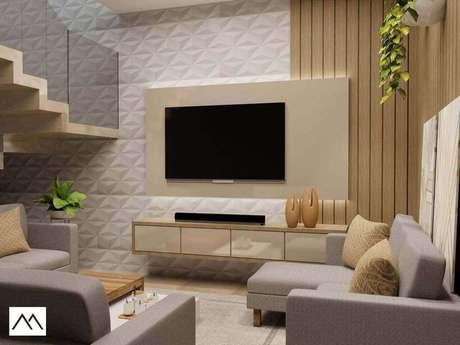 61. Nesta sala, o papel de parede 3D fica ótimo associado ao rack suspenso. Projeto de Studio MBS Arquitetura