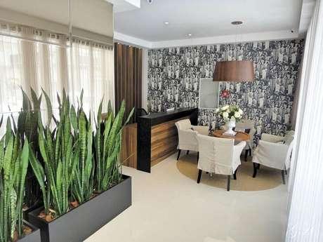 44. Você também pode usar vasos para plantas na decoração do escritório