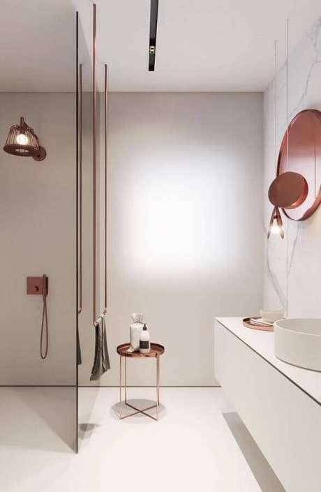 33. Decoração minimalista para banheiro feminino branco com detalhes em rose gold – Foto: Wood Save