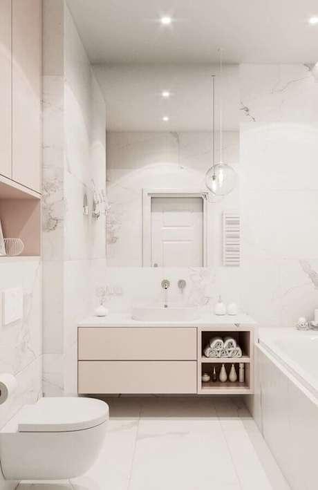 34. Delicada decoração para banheiro feminino branco e rosa pastel – Foto: Eduardo Cavalcanti Castro