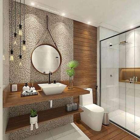 38. Decoração de banheiro feminino em tons neutros com bancada de madeira e revestimento de pedra – Foto: Pinterest