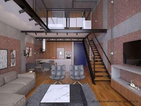 13. Loft industrial com sala com escada e cozinha americana. Projeto por Studio Scatena