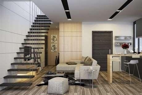 47. Sala com escada preta flutuante. Fonte: Pinterest