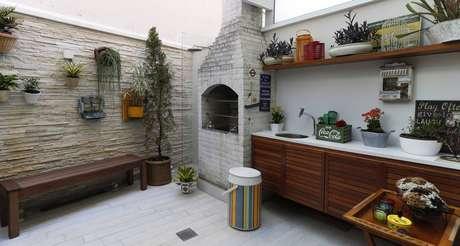 33. Área de churrasqueira em varanda Gourmet