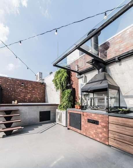 1. Área de churrasco estruturada na cobertura. Projeto por Pietro Terlizzi