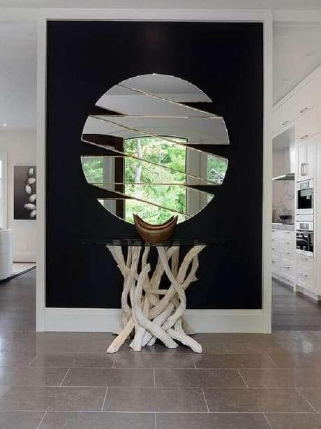 61. Espelho decorativo redondo moderno com recortes vazados – Foto: Ideias para Decorar