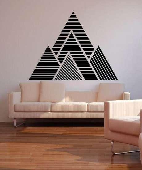 2. Parede decorada com fita isolante para sala minimalista com sofá rosa claro – Foto: Casa e Festa