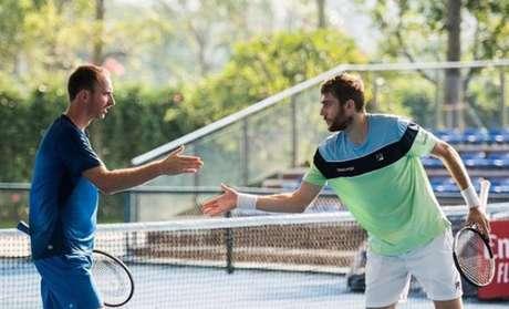 O tenista brasileiro Marcelo Demoliner e o holandês Matwe Middelkoop