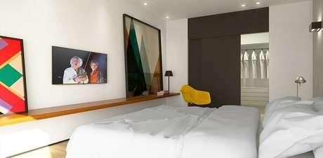 29. Quarto clean com quadros grandes e cadeira amarela. Projeto por Cezar Augusto Pires