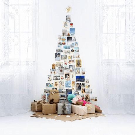 5. Como fazer árvore de Natal na parede com fotos de família. Fonte: Pinterest