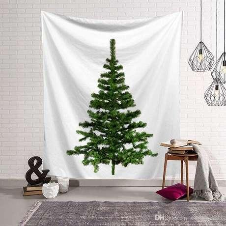 74. Utilize um tecido com desenho de árvore de Natal e decore seu ambiente. Fonte: Pinterest