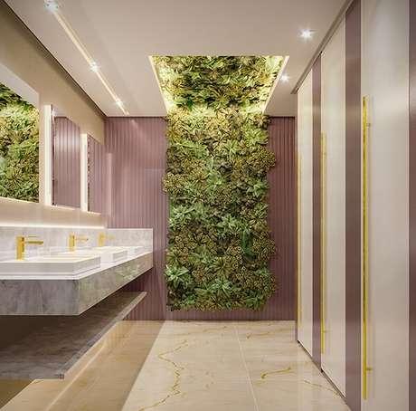 3. Lavabo feminino deslumbrante com jardim vertical artificial. Projeto por Samara Abi