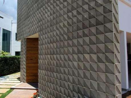 43. A parede 3D pode se assemelhar ao concreto. Projeto de Mutabile Arquitetura e Design Gráfico