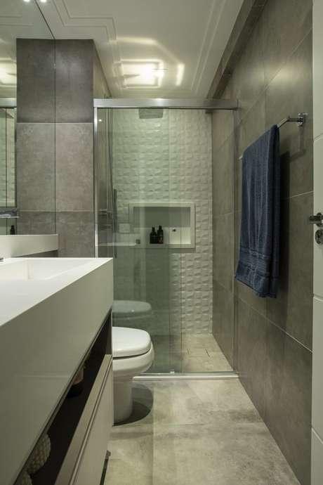 11. Banheiros também podem ter parede 3D. Projeto de LAM Arquitetura & Interiores