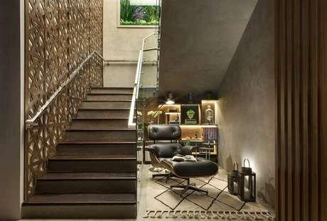 2. Cantinho especial da leitura com decoração de parede cimento queimado. Fonte Casaccor Franca 17