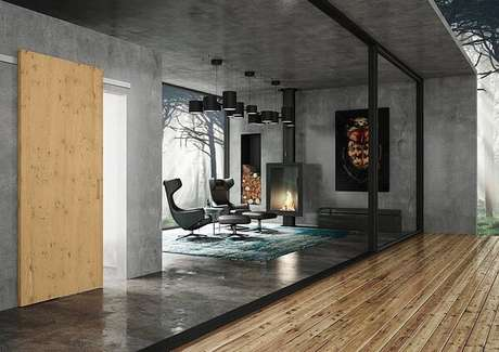 43. Poltronas de couro e parede de cimento queimado decoram o ambiente. Fonte: Revista Viva Decora