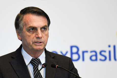 Presidente Jair Bolsonaro discursa em evento com empresários em Pequim 25/10/2019 Madoka Ikegami/Pool via REUTERS
