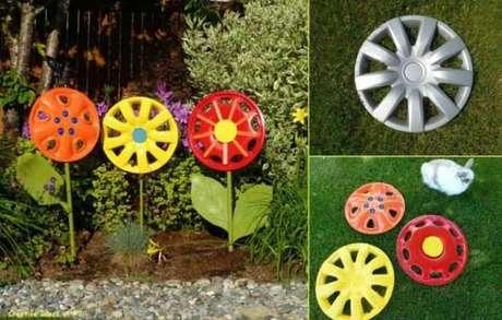 75. As calotas de carro formaram lindos enfeites para jardim. Fonte: Pinterest