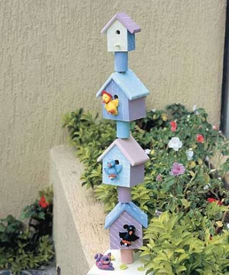 47. Enfeites para jardim feitos em madeira. Fonte: Pinterest