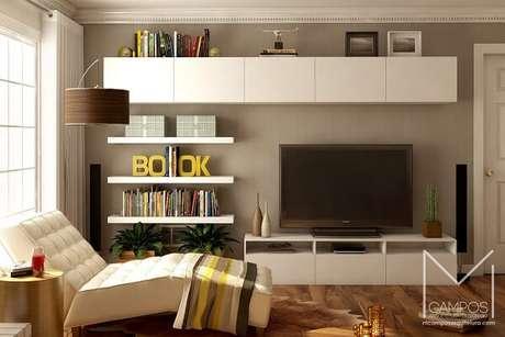 49. Invista em poltronas para sala de tv super aconchegante. Fonte: MCampos Arquitetura